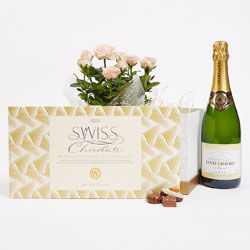 Pink roses, swiss chocolates and champagne box