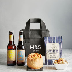 Two bottles of beer, pork pie, pie shreds and a cooler bag