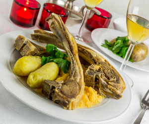 Roast Lamb on Potatoes with White wine
